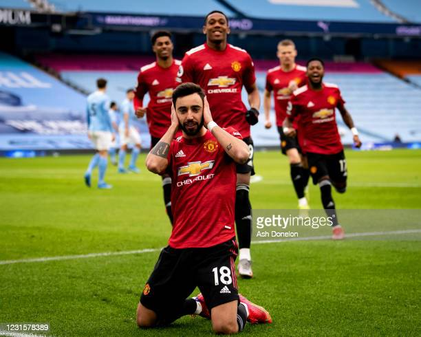 Bruno Fernandes of Manchester United celebrates scoring a goal to make the score 0-1 during the Premier League match between Manchester City and...
