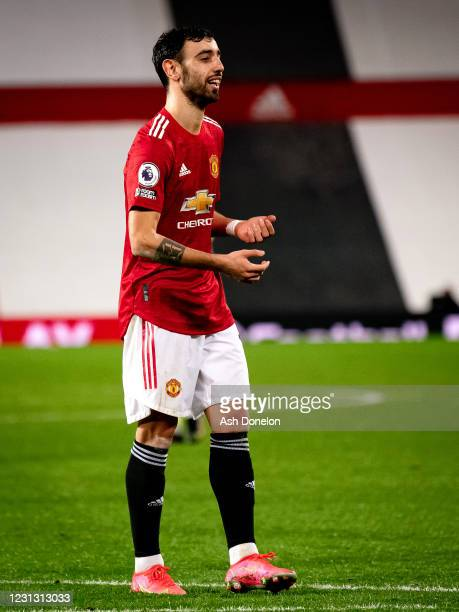 Bruno Fernandes of Manchester United celebrates scoring a penalty to make the score 3-1 during the Premier League match between Manchester United and...