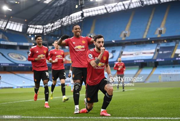 Bruno Fernandes of Manchester United celebrates scoring the first goal from a penalty during the Premier League match between Manchester City and...