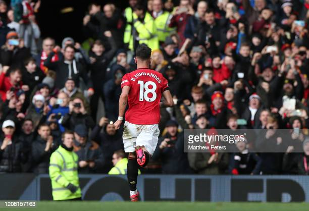 Bruno Fernandes of Manchester United celebrates scoring their first goal during the Premier League match between Manchester United and Watford FC at...