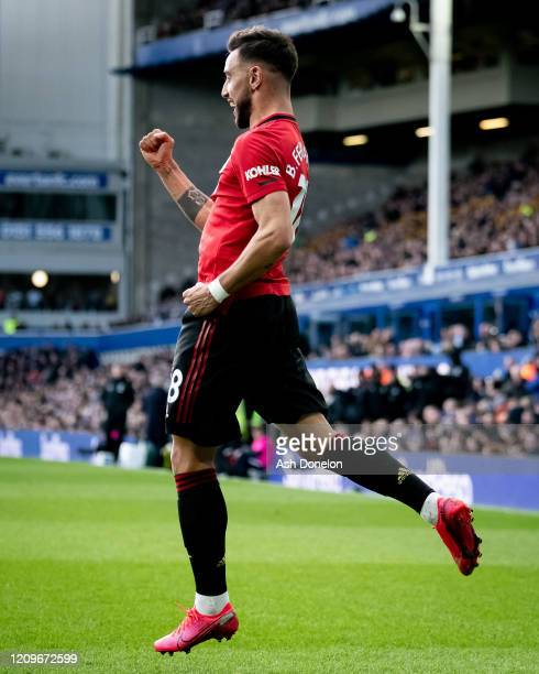 Bruno Fernandes of Manchester United celebrates scoring their first goal during the Premier League match between Everton FC and Manchester United at...