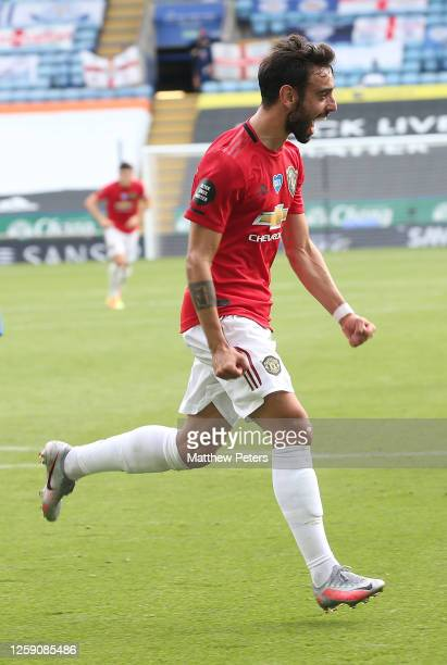 Bruno Fernandes of Manchester United celebrates scoring their first goal during the Premier League match between Leicester City and Manchester United...