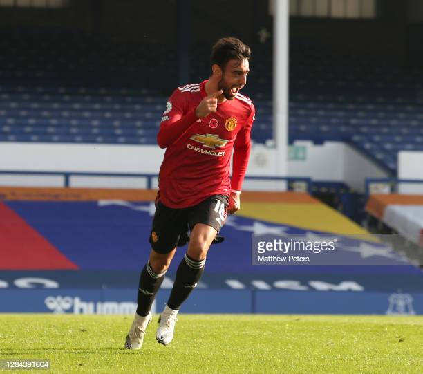 Bruno Fernandes of Manchester United celebrates scoring their first goal during the Premier League match between Everton and Manchester United at...