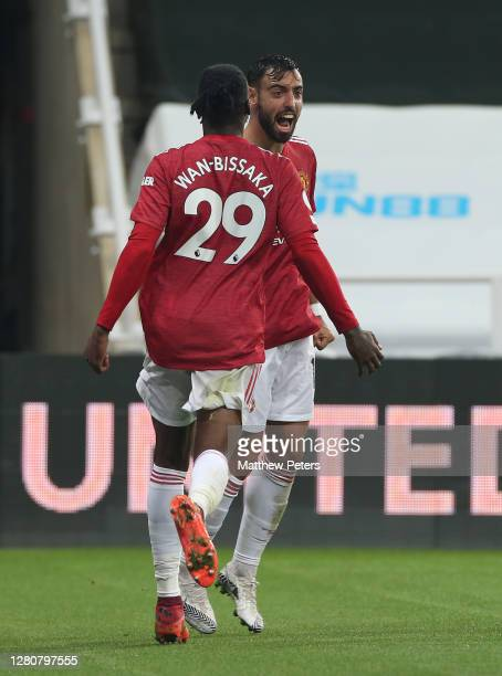 Bruno Fernandes of Manchester United celebrates scoring their second goal during the Premier League match between Newcastle United and Manchester...