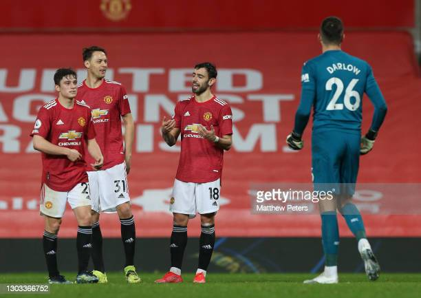 Bruno Fernandes of Manchester United celebrates scoring their third goal during the Premier League match between Manchester United and Newcastle...