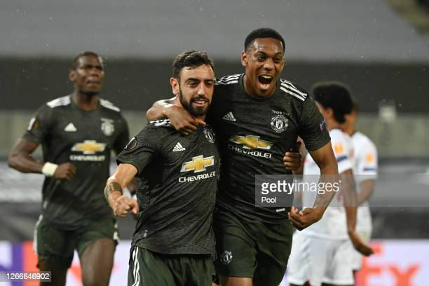 Bruno Fernandes of Manchester United celebrates with Anthony Martial after scoring his team's first goal from the penalty spot during the UEFA Europa...