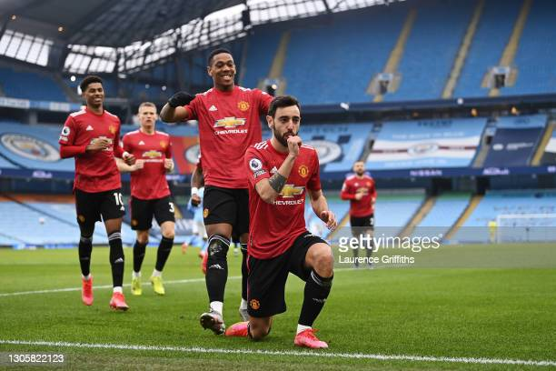Bruno Fernandes of Manchester United celebrates with Anthony Martial after scoring their side's first goal from the penalty spot during the Premier...