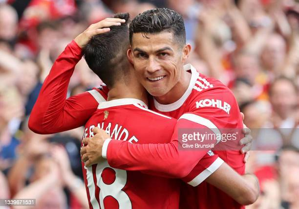 Bruno Fernandes of Manchester United celebrates with Cristiano Ronaldo after scoring their side's third goal during the Premier League match between...