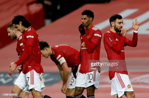 Bruno Fernandes of Manchester United celebrates with Edinson Cavani, Marcus Rashford and team mates after scoring their side's third goal during The...