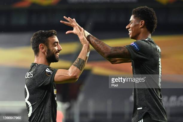 Bruno Fernandes of Manchester United celebrates with Marcus Rashford after scoring his team's first goal from the penalty spot during the UEFA Europa...