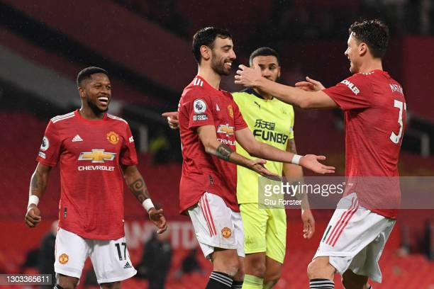 Bruno Fernandes of Manchester United celebrates with Nemanja Matic after scoring his team's third goal from the penalty spot during the Premier...