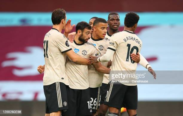 Bruno Fernandes of Manchester United celebrates with team mates after scoring the opening goal from a penalty kick during the Premier League match...
