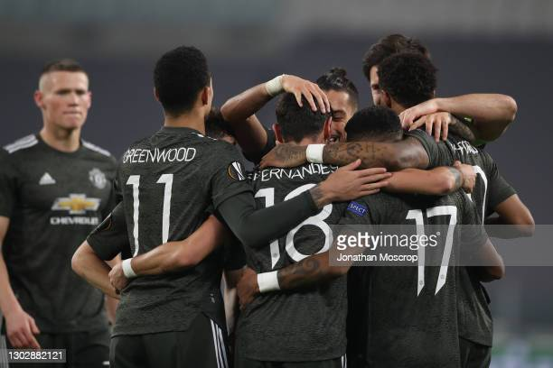 Bruno Fernandes of Manchester United celebrates with team mates after scoring to give the side a 2-0 lead during the UEFA Europa League Round of 32...