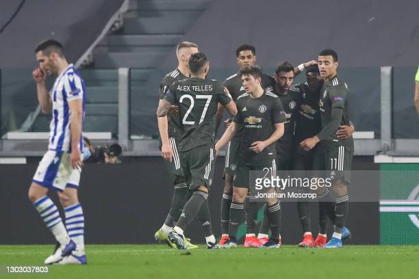 Bruno Fernandes of Manchester United celebrates with team mates after scoring to give the side a 1-0 lead during the UEFA Europa League Round of 32...