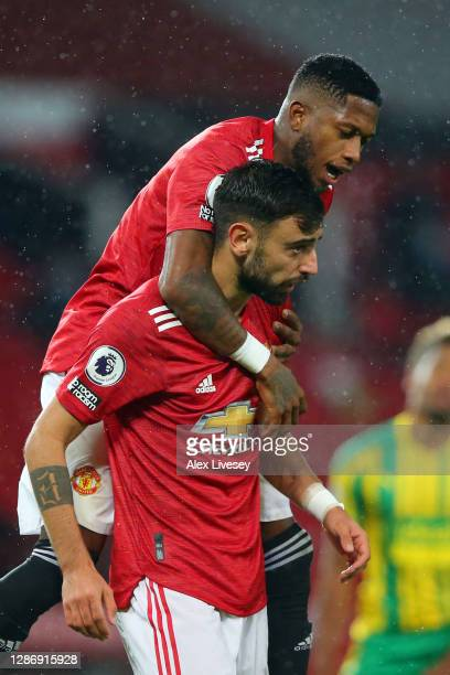 Bruno Fernandes of Manchester United celebrates with teammate Fred after scoring his team's first goal during the Premier League match between...