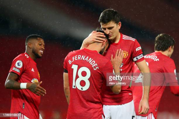 Bruno Fernandes of Manchester United celebrates with teammate Harry Maguire after scoring his team's first goal during the Premier League match...
