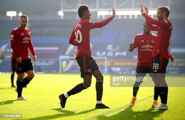 Bruno Fernandes of Manchester United celebrates with teammate Marcus Rashford after scoring his team's second goal after scoring his team's second...