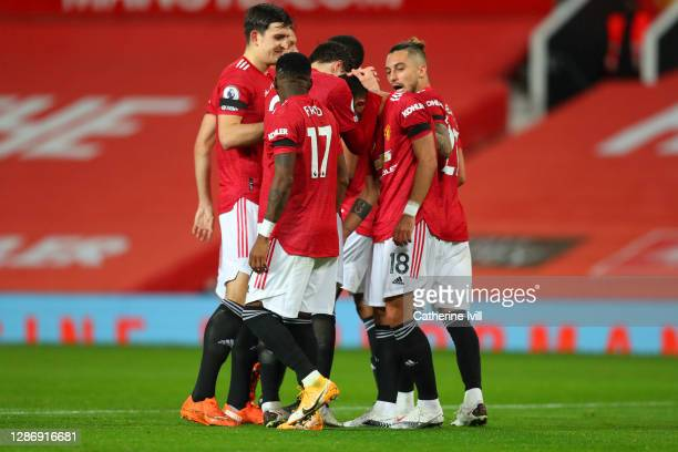 Bruno Fernandes of Manchester United celebrates with teammate Victor Lindelof after scoring his team's first goal during the Premier League match...