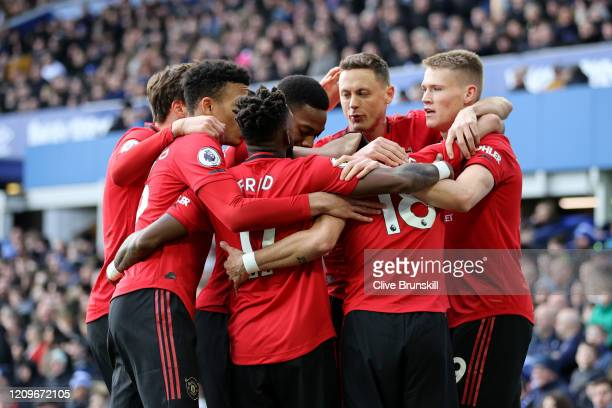 Bruno Fernandes of Manchester United celebrates with teammates after scoring his team's first goal during the Premier League match between Everton FC...