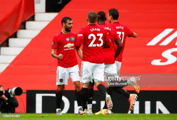 Bruno Fernandes of Manchester United celebrates with teammates after scoring his team's fifth goal from a free kick during the Premier League match...