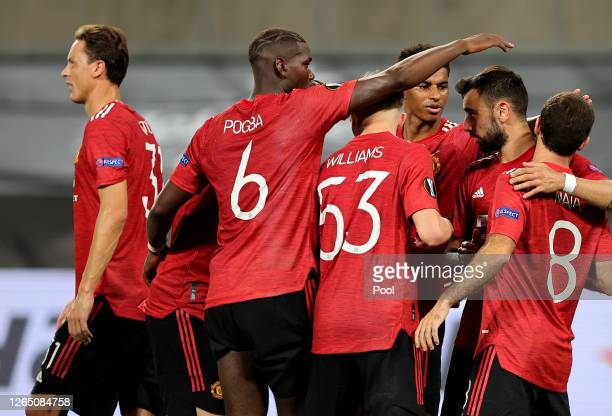 Bruno Fernandes of Manchester United celebrates with teammates after scoring his sides first goal during the UEFA Europa League Quarter Final between...