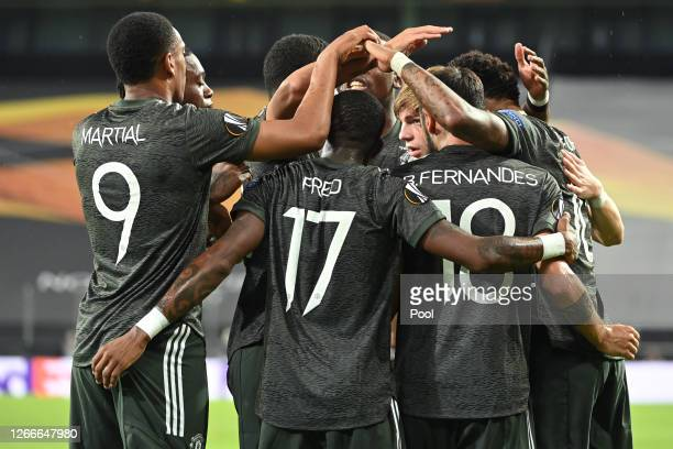 Bruno Fernandes of Manchester United celebrates with teammates after scoring his team's first goal from the penalty spot during the UEFA Europa...