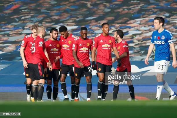 Bruno Fernandes of Manchester United celebrates with teammates after scoring his team's second goal during the Premier League match between Everton...