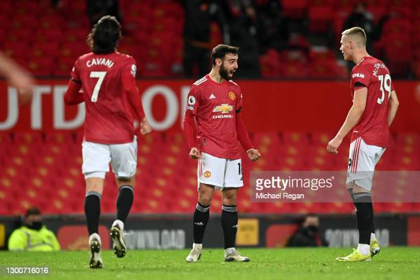 Bruno Fernandes of Manchester United celebrates with teammates Edinson Cavani and Scott McTominay after scoring their team's second goal during the...
