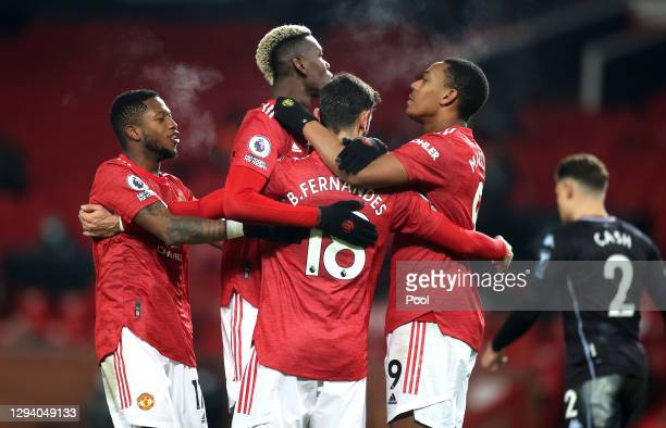 Bruno Fernandes of Manchester United celebrates with teammates Fred, Paul Pogba and Anthony Martial after scoring their team's second goal during the...