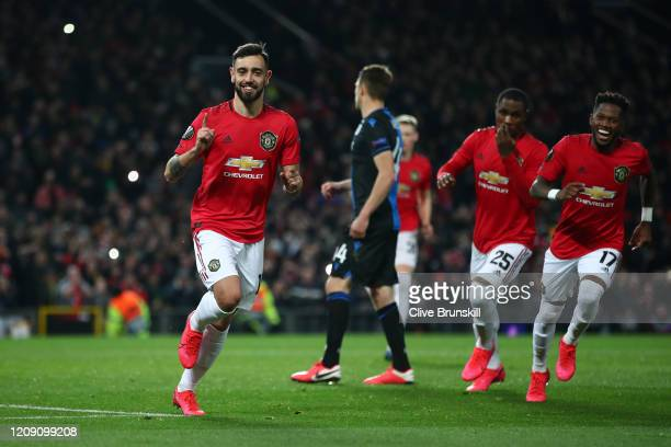 Bruno Fernandes of Manchester United celebrates with teammates Odion Ighalo and Fred of Manchester United after scoring his team's first goal from...