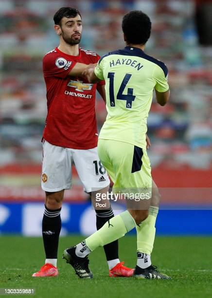Bruno Fernandes of Manchester United clashes with Isaac Hayden of Newcastle United during the Premier League match between Manchester United and...