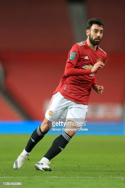Bruno Fernandes of Manchester United in action during the Carabao Cup Semi Final match between Manchester United and Manchester City at Old Trafford...