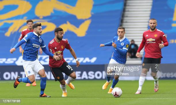 Bruno Fernandes of Manchester United in action with Adam Lallana of Brighton and Hove Albion during the Premier League match between Brighton Hove...