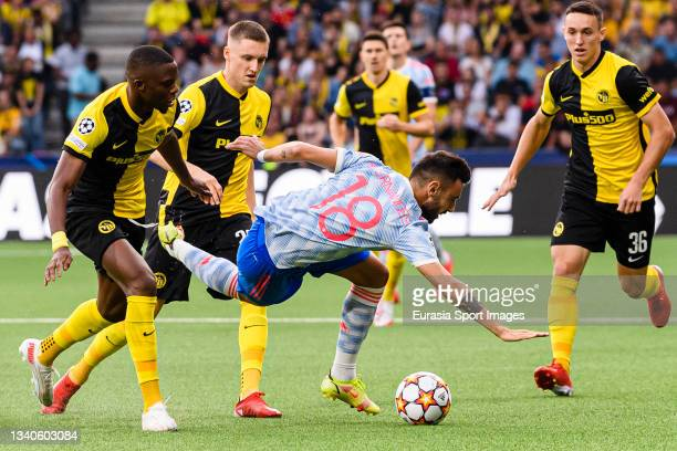 Bruno Fernandes of Manchester United is challenged by Christopher Martins of Young Boys during the UEFA Champions League group F match between BSC...