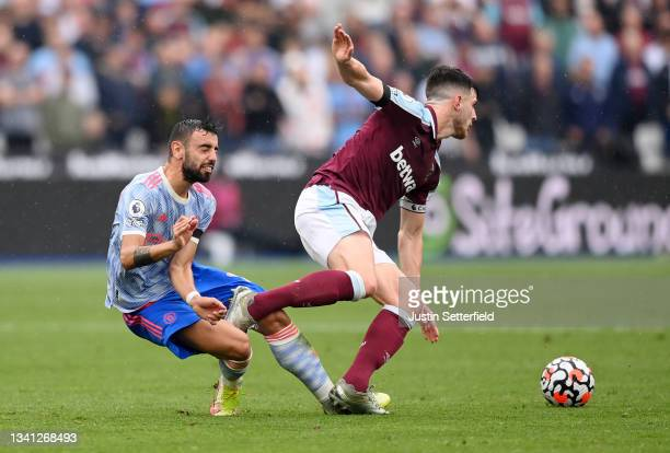 Bruno Fernandes of Manchester United is challenged by Declan Rice of West Ham United during the Premier League match between West Ham United and...