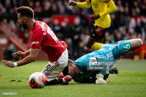 Bruno Fernandes of Manchester United is fouled by Ben Foster of Watford and wins a penalty during the Premier League match between Manchester United...