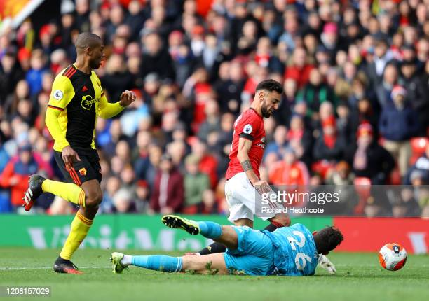 Bruno Fernandes of Manchester United is fouled by Ben Foster of Watford resulting in a penalty during the Premier League match between Manchester...