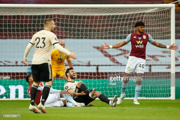 Bruno Fernandes of Manchester United is fouled by Ezri Konsa Ngoyo of Aston Villa and a penalty is awarded as Tyrone Mings of Aston Villa reacts...