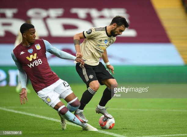 Bruno Fernandes of Manchester United is fouled by Ezri Konsa Ngoyo of Aston Villa and a penalty is awarded during the Premier League match between...