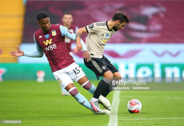 Bruno Fernandes of Manchester United is fouled by Ezri Konsa Ngoyo of Aston Villa to win a penalty kick during the Premier League match between Aston...