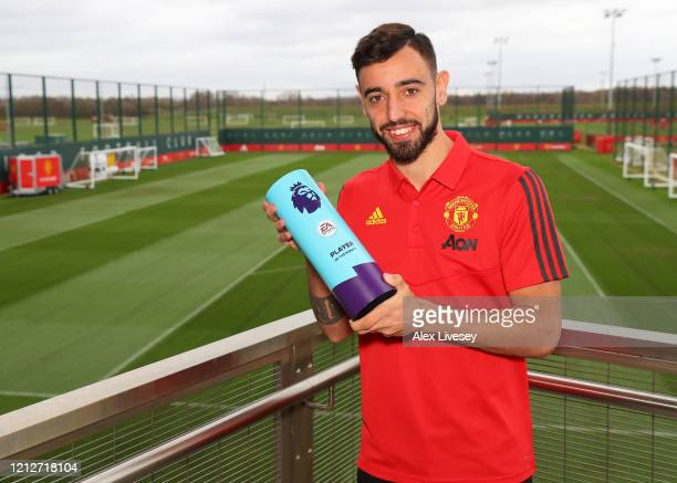 Bruno Fernandes of Manchester United is Presented with the Premier League Player of the Month for February at Aon Training Complex on March 10 2020...