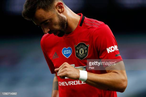 Bruno Fernandes of Manchester United is seen with the NHS heart logo on his shirt during the Premier League match between Tottenham Hotspur and...