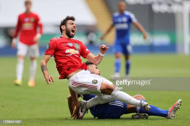 Bruno Fernandes of Manchester United is tackled by James Justin of Leicester City during the Premier League match between Leicester City and...