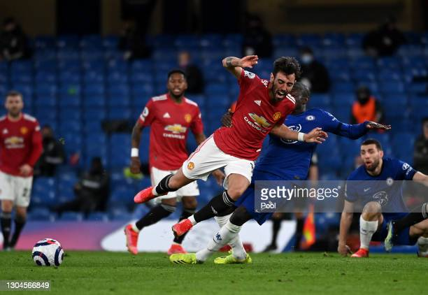 Bruno Fernandes of Manchester United is tackled by N'Golo Kante of Chelsea during the Premier League match between Chelsea and Manchester United at...