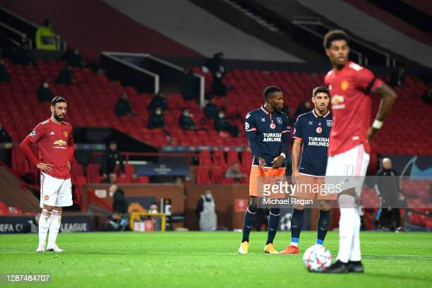 Bruno Fernandes of Manchester United looks on as team mate Marcus Rashford of Manchester United prepares to take a penalty, leading to their team's...