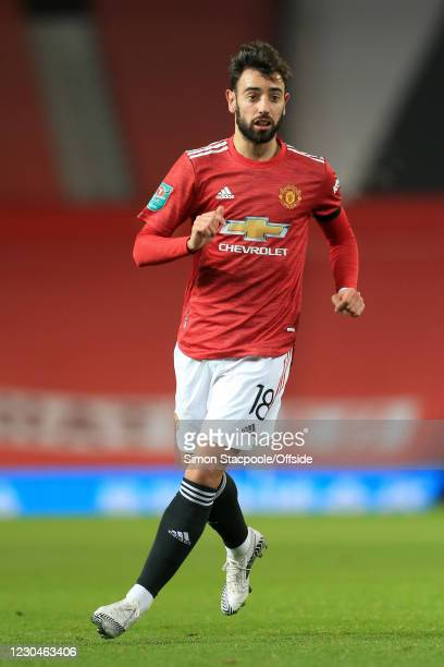 Bruno Fernandes of Manchester United looks on during the Carabao Cup Semi Final match between Manchester United and Manchester City at Old Trafford...