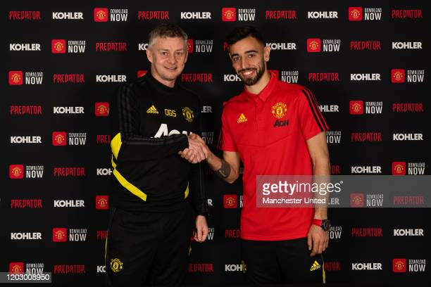 Bruno Fernandes of Manchester United poses with Manager Ole Gunnar Solskjaer after signing for the club at Aon Training Complex on January 30 2020 in...
