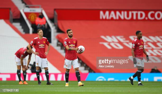 Bruno Fernandes of Manchester United reacts after Tottenham Hotspur score their first goal during the Premier League match between Manchester United...