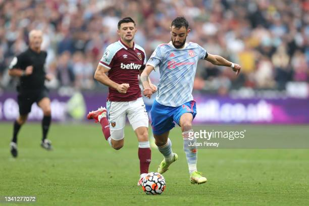 Bruno Fernandes of Manchester United runs with the ball during the Premier League match between West Ham United and Manchester United at London...