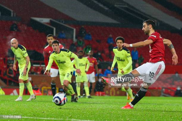 Bruno Fernandes of Manchester United scores a goal from a penalty to make it 3-1 during the Premier League match between Manchester United and...